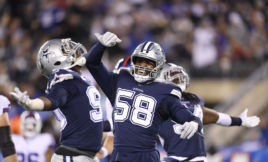 Robert Quinn, Dallas Cowboys reacts with teammates Demarcus Lawrence #90 and Jaylon Smith #54